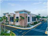 Image of Extra Space Self Storage Facility on 10400 Riverside Dr in Palm Beach Gardens, FL